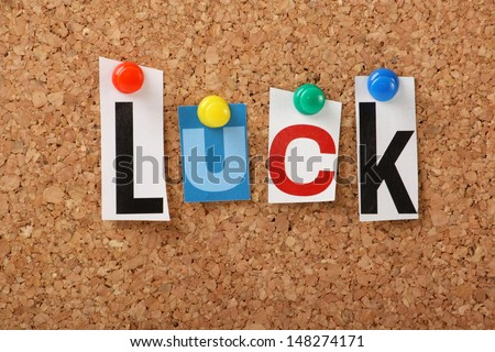The word Luck in cut out magazine letters pinned to a cork notice board. Luck is necessary for any business venture or change of direction in our personal lives.