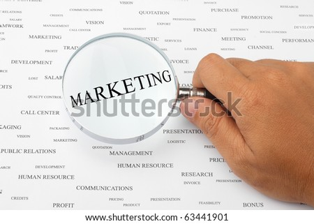 The word MARKETING is magnified. - stock photo