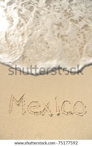 The Word Mexico Written in the Sand on a Beach