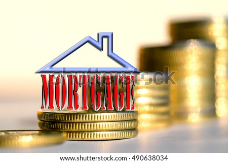 """The word """" mortgage """" in the background the columns of coins ."""