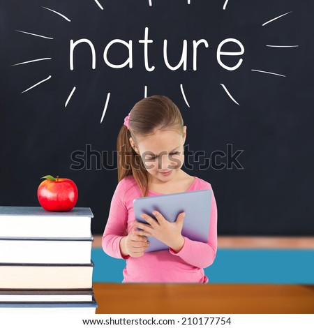 The word nature and cute girl using tablet against red apple on pile of books in classroom