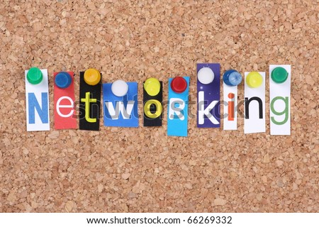 The word Networking in cut out magazine letters pinned to a cork notice board as a concept for communication in business and social relationships