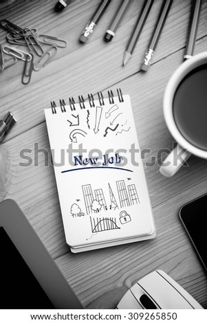 The word new job and business and cityscape against notepad on desk