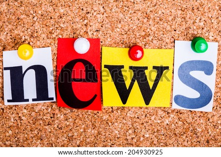 The word news in cut out magazine letters pinned to a cork notice board.