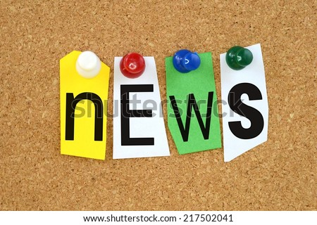The word news in cut out magazine letters pinned to a cork notice board