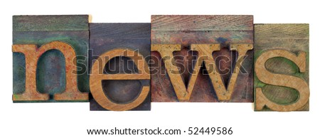 the word news in vintage wooden letterpress type, lower case, stained by colorful inks, isolated on white - stock photo
