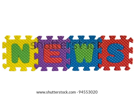 """The word """"News"""" written with alphabet puzzle letters isolated on white background"""