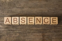the word of ABSENCE on a wooden cubes