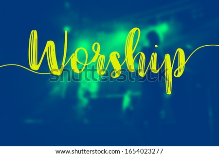 """The word of """"Worship"""" and the hall in church christian music concert.Blurred background of people raised hands and shouting worship concert.Christian background for worship.Duo tone."""