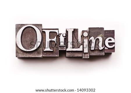 "The word ""Offline"" done in letterpress type on a white paper background."