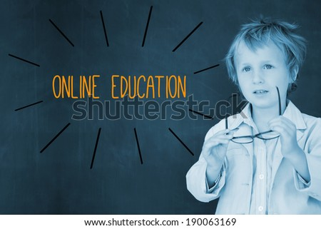 The word online education against schoolboy and blackboard - stock photo