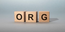 The word Org written on cube blocks on grey blue background