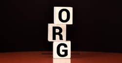 The word Org written on cube blocks on grey blue background with copy space available