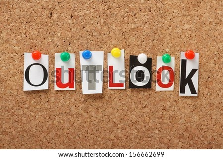 The word Outlook in cut out magazine letters pinned to a cork notice board. Outlook may apply to the weather forecast, the economy or your point of view and attitude to life.