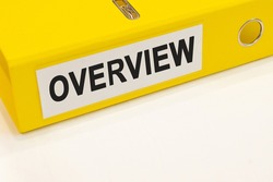 The word overview on a white background with a yellow folder. Business concept