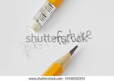 The word past erased with a rubber and the word future written with a pencil on white paper - Concept of time, clearing the past and building a future Stock photo ©