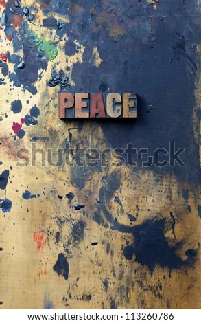 The word peace written in antique letterpress printing blocks.