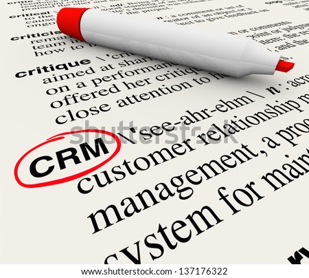 The word, phrase or acronym CRM which means Customer Relationship Management defined in a dictionary with the definition circled by a red marker