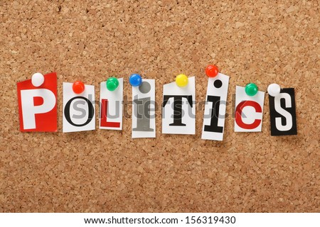 The word Politics in cut out magazine letters pinned to a cork notice board.