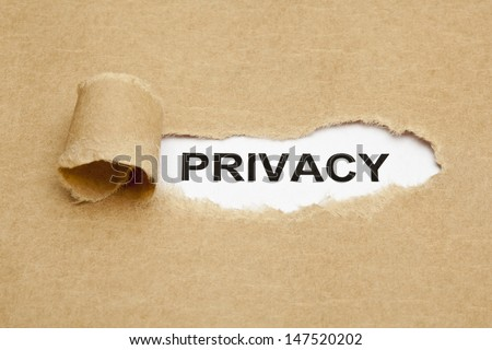 The word Privacy appearing behind torn brown paper.