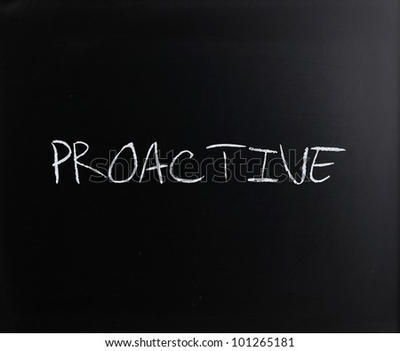 The word 'Proactive' handwritten with white chalk on a blackboard.