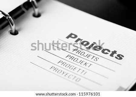 The word projects in different languages closeup in organizer
