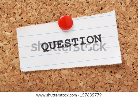 The word Question typed onto a scrap of lined paper and pinned to a cork notice board. We learn to question as part of our education and career development.