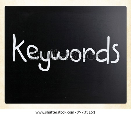 "The word ""Keywords&quot ; handwritten with white chalk on a blackboard - stock photo"