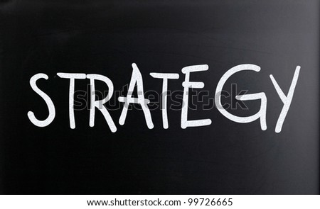 "The word ""Strategy&quot ; on a blackboard - stock photo"