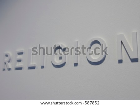 The Word &Quot;Religion&Quot; Embossed On A White Wall, Partially ...