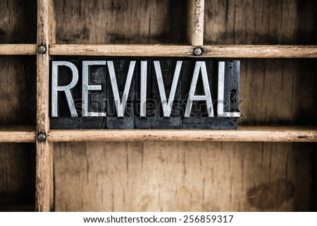 The word 'REVIVAL' written in vintage metal letterpress type in a wooden drawer with dividers. Сток-фото ©