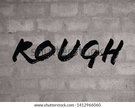 the word rough on a rough wall background