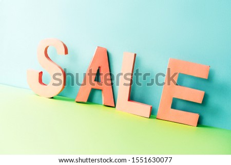 The word SALE from volume paper letters. Zero Wast content for seasonal discounts and Black Friday.