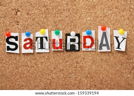 The word Saturday in cut out magazine letters pinned to a cork notice board