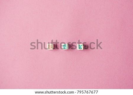 The Word SEX on pink background. #795767677