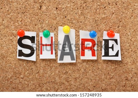 The word Share in cut out magazine letters pinned to a cork notice board, Sharing files, photos and information is an increasing aspect of social networking, online marketing and blogging.