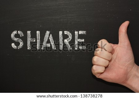 The word Share on a blackboard next to a hand giving the thumbs up gesture