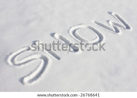 "The word ""SNOW"" imprinted in a fresh snowy field under bright sunlight"