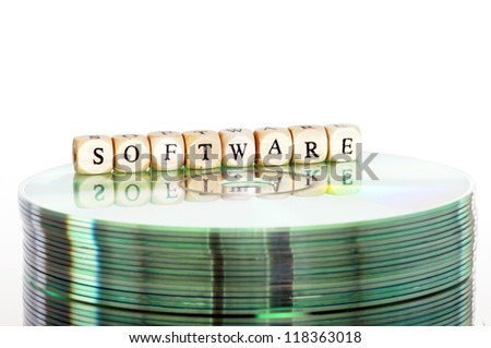 The word Software written in wooden letters standing on a computer-CD