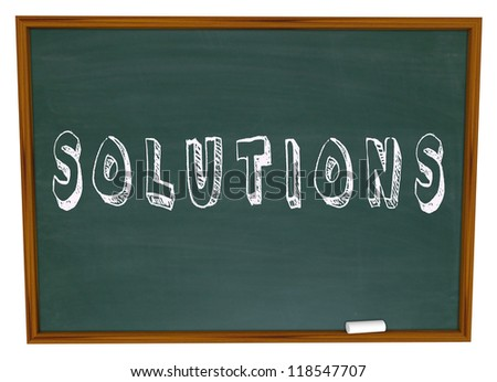 The word Solutions written on a school chalkboard to symbolize learning to vind answers to life's challenges, problems and issues