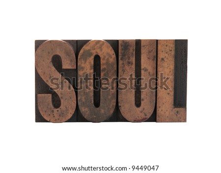 the word 'soul' in old, ink-stained wood letters isolated on white