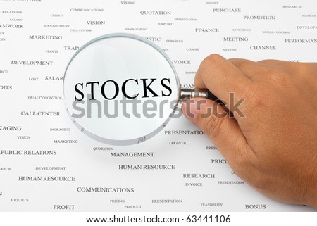 The word STOCKS is magnified.