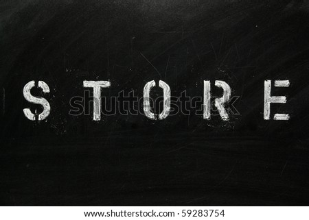 The word STORE in stencil letters on a blackboard