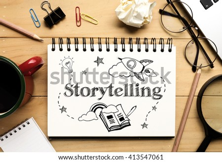 """The word """"Storytelling"""" on notebook and wooden desk background (Business Concept) #413547061"""