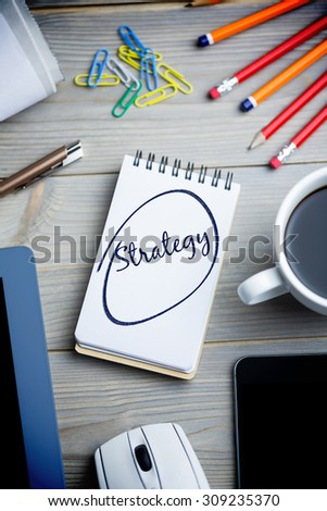 The word strategy against notepad on desk