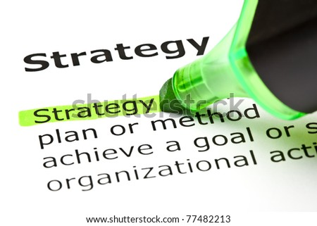 The word Strategy highlighted in green with felt tip pen. - stock photo