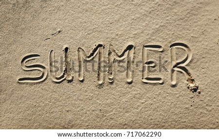 The word Summer is written on the sand #717062290