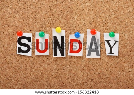 The word Sunday in cut out magazine letters pinned to a cork notice board. In many societies, Sunday is the main day of worship but in general is a time for rest and relaxation.