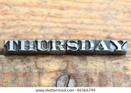 the word thursday in letterpress type on a wooden background Thursday Word