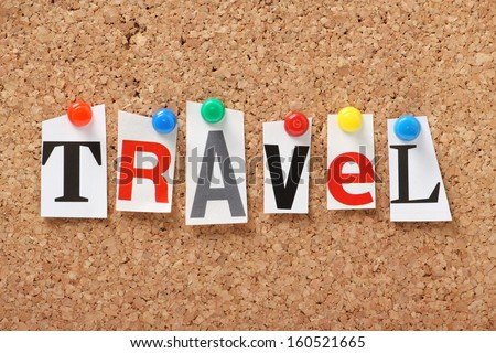 The word Travel in cut out magazine letters pinned to a cork notice board. We check the news for Travel and transport issues and read the travel sections of the newspapers for holiday inspiration.
